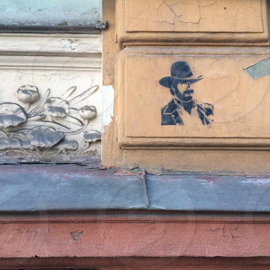 Close-up of old building in Riga Latvia with stencil art photo