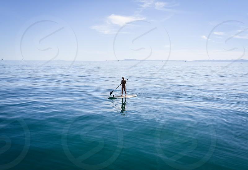 alone paddle board ocean photo