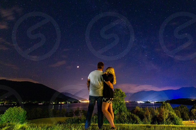 Family night alps mountain forest lake eclipse  photo