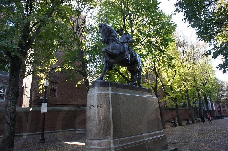 black man on horse statue photo
