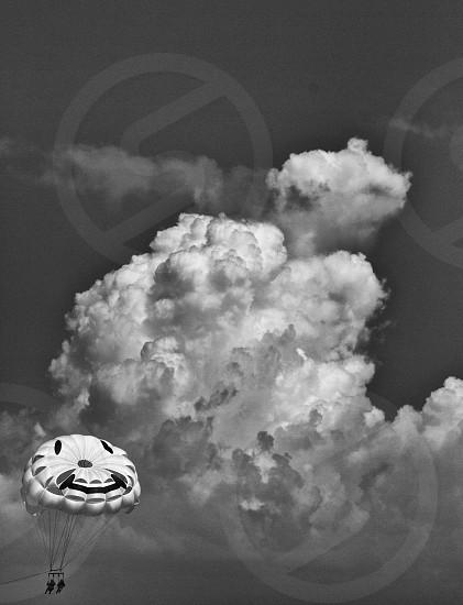 white parachute near clouds photo