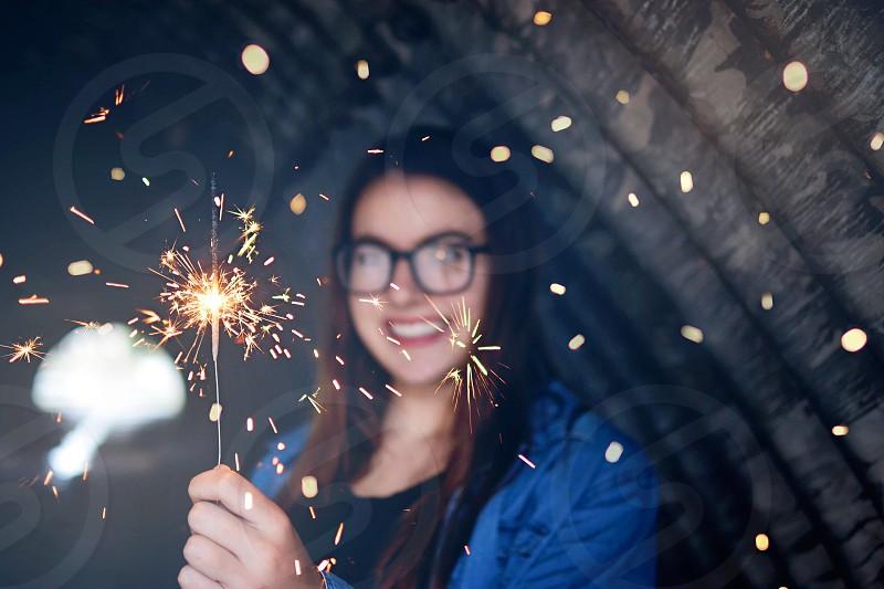 Young girl sparkler photo