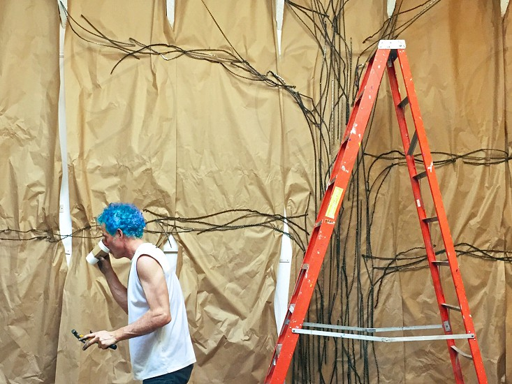 Artist ladder mural in progress  photo