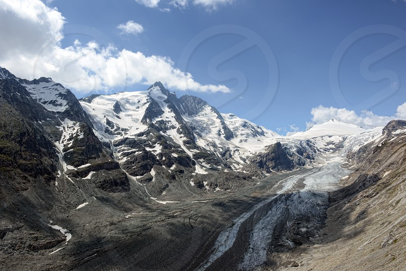 Grossglocker mountain area with snow in summer time. Pasterze Glacier photo