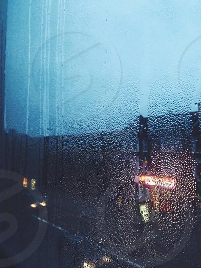 night London city urban rain window drop water droplets blue sad melancholy  photo