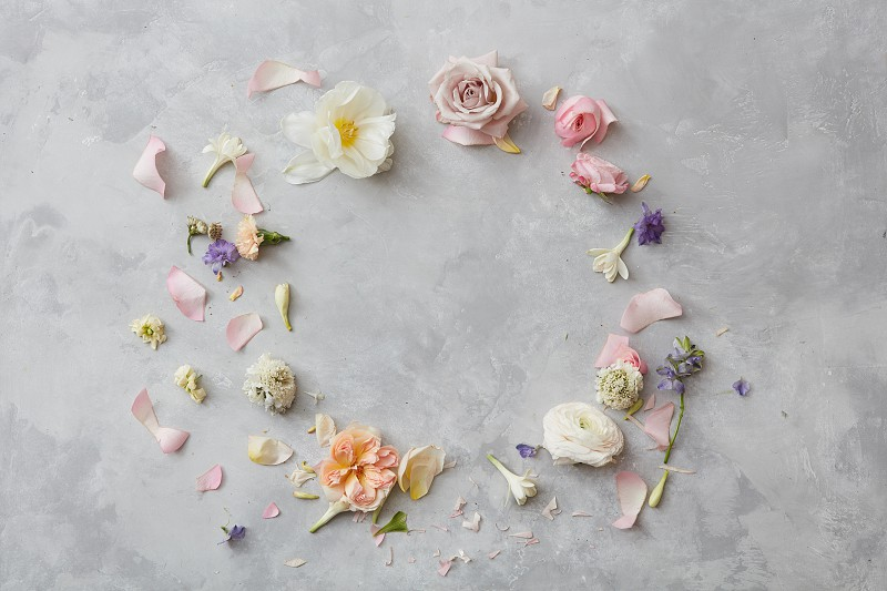 beautiful round frame of flowers on a concrete background flat lay photo