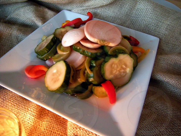 Pickled vegetables served on burlap outdoors photo