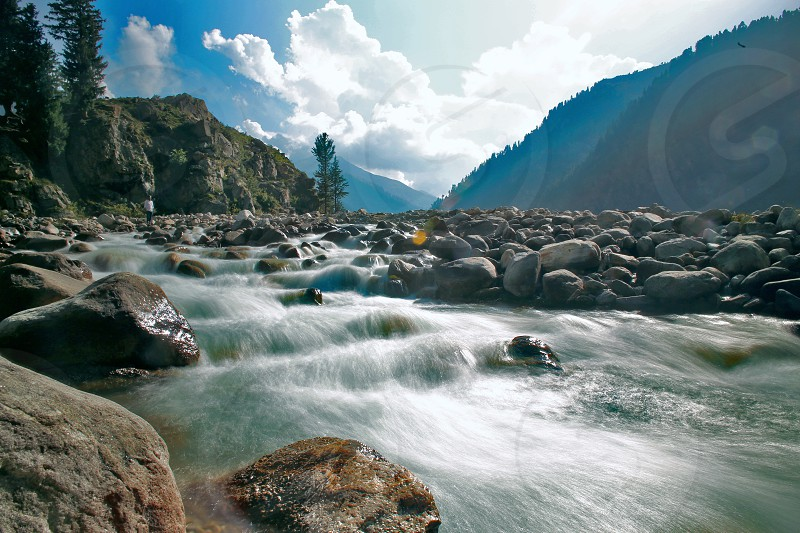 Nature water scenery northern area river flow ricks outdoor tourism photo