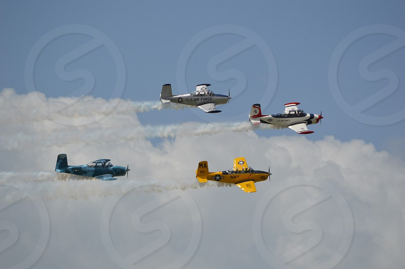 four biplanes above clouds during daytime photo