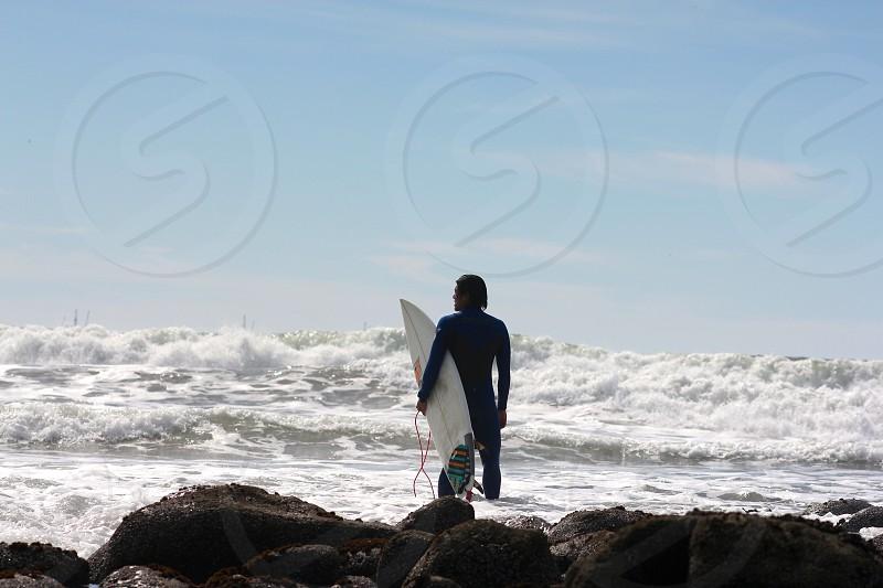 Wave check ocean surf surfer wetsuit beach California Rincon photo