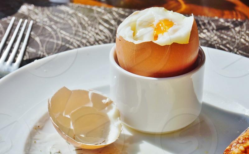 Eating a soft boiled egg for breakfast photo