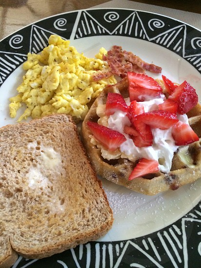 Big Breakfast  ( eggs strawberries whole wheat toast  ) photo