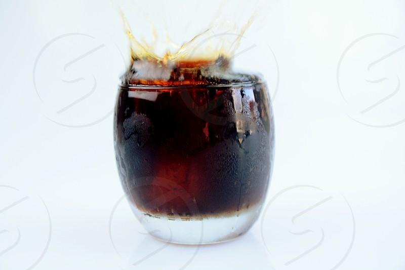 splash cold coke black white drink photo