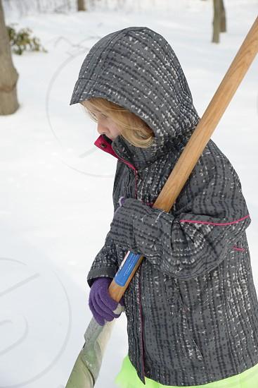 SnowWinterChildShovelingCold photo