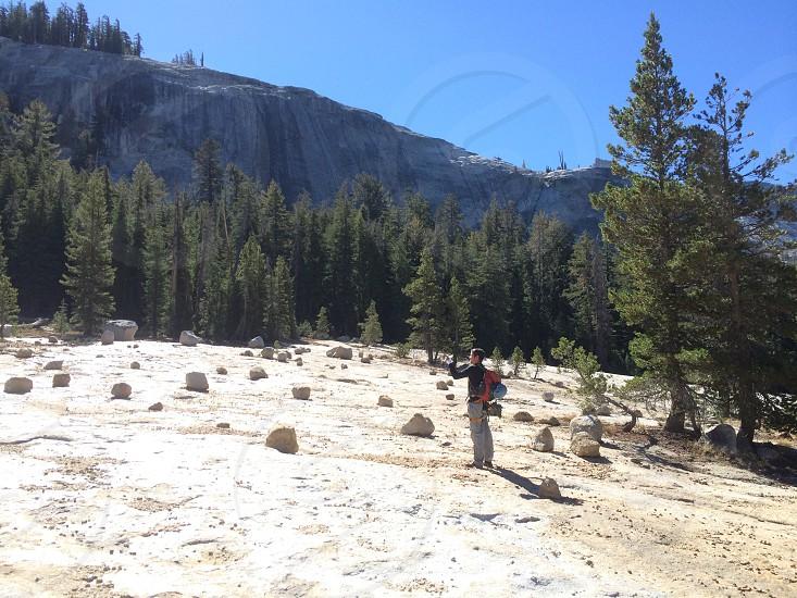 man taking photo on snowy mountain photo