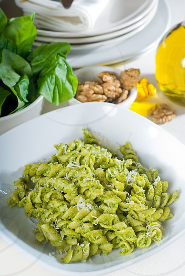 italian fusilli pasta and fresh homemade  pesto sauce photo