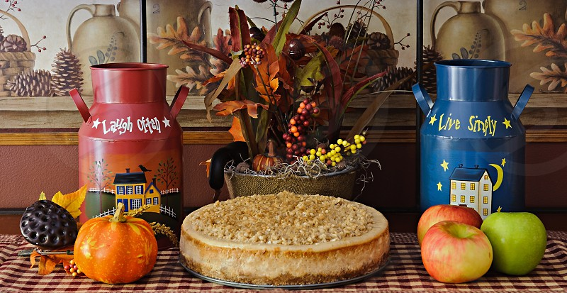 Food Photography - Whole Caramel Apple Crisp Cheesecake in a fall arrangement. photo