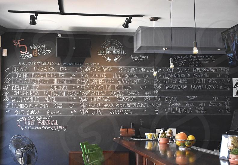 black stand fan beside black chalkboard near brown wooden table photo