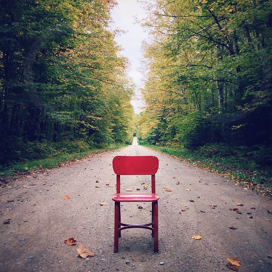 picture or a red chair on the road photo