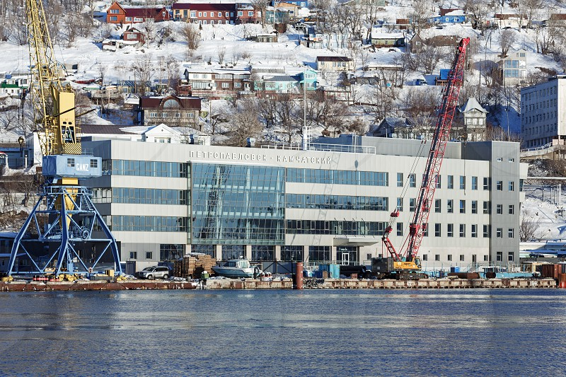 PETROPAVLOVSK-KAMCHATSKY CITY KAMCHATKA PENINSULA RUSSIA - DECEMBER 31 2016: Winter view of new modern building of Marine Station in commercial sea port Petropavlovsk-Kamchatsky on Avacha Bay. photo