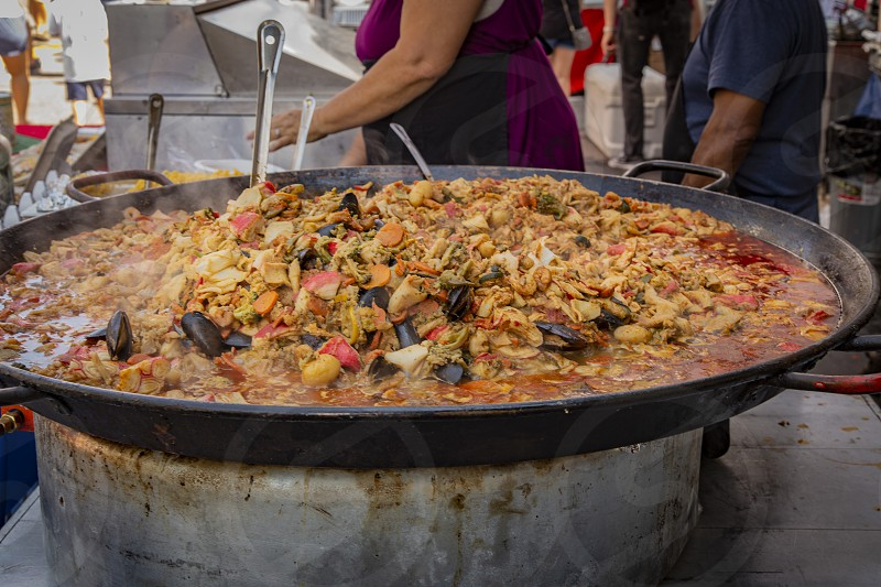Steaming paella being served at outdoor food fair in Belmar shopping area in Lakewood Colorado photo