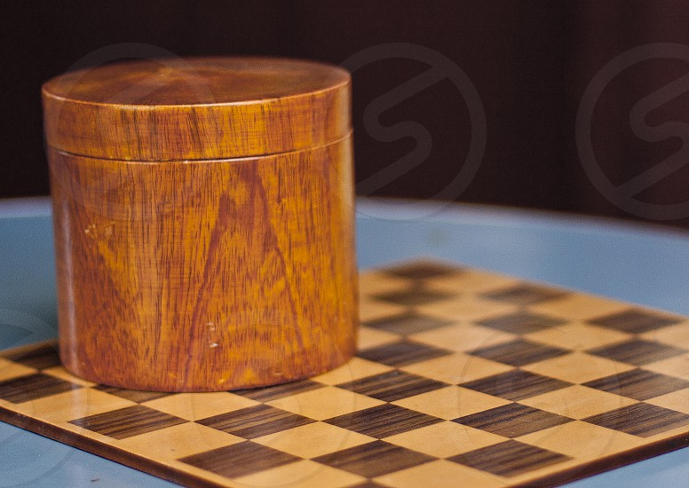 Vintage checker board with round wooden container. photo