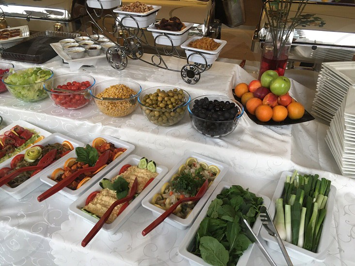 varieties of fruits and vegetables on top of buffet table photo