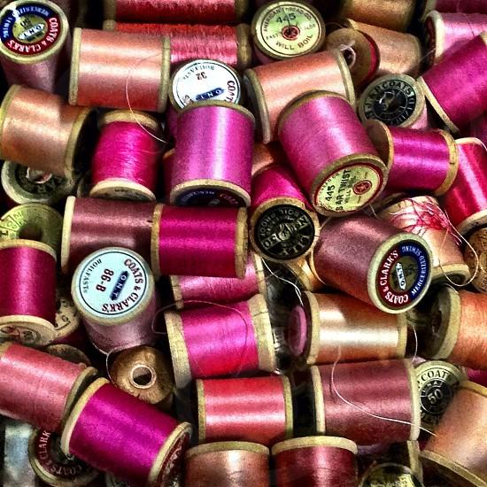 pink thread spools  photo
