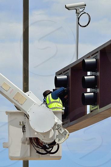 Civic Engineer Fixing Traffic light. photo