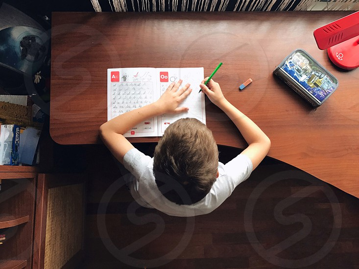 School home tasks back to school learning lifestyle education lifestyle education science school boy books copy books writinghand writing kid table desk desktop overhead  photo