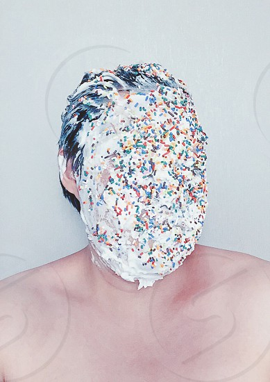 man with icing on face photo