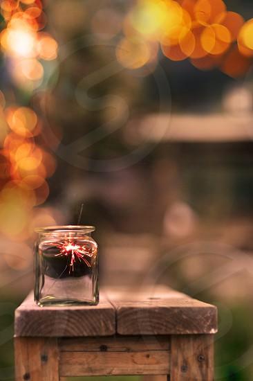 spaklers lights bokeh table wood mason jar candle blur summer spring outdoors photo