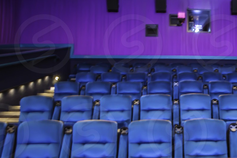 movie theater with projector playing photo