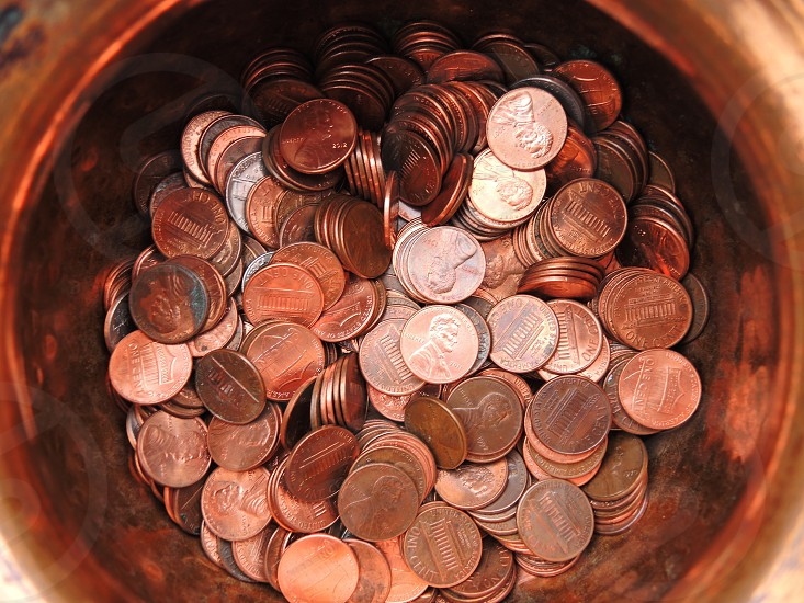 round copper bowl of penny coins photo
