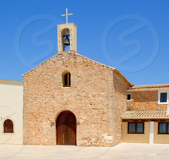 Sant Ferran stone church with belfry in Formentera island of Spain photo