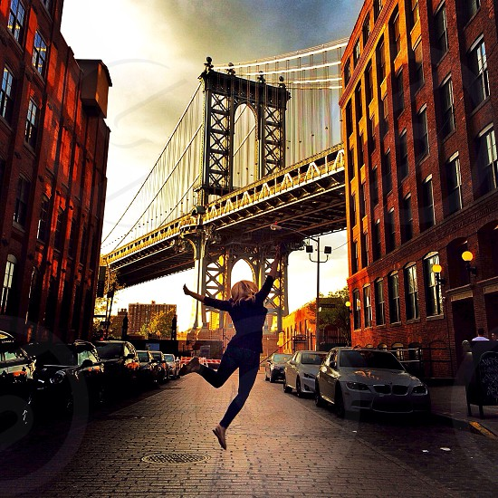 woman jumping on road in panoramic photography photo