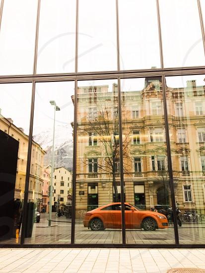 Orange car reflection photo