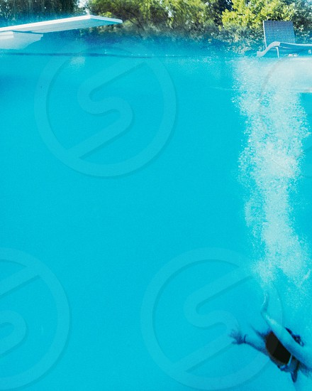 My niece under water at her pool  photo
