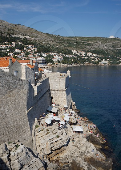 """Cafe on the rocks"" outside Dubrovnik old town walls photo"