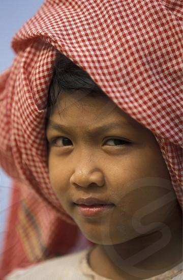 Ein Maedchen am Tonle Sap Lake bei Siem Reap und der Ruinenstadt von Angkor in Kambotscha in Suedost Asien. photo