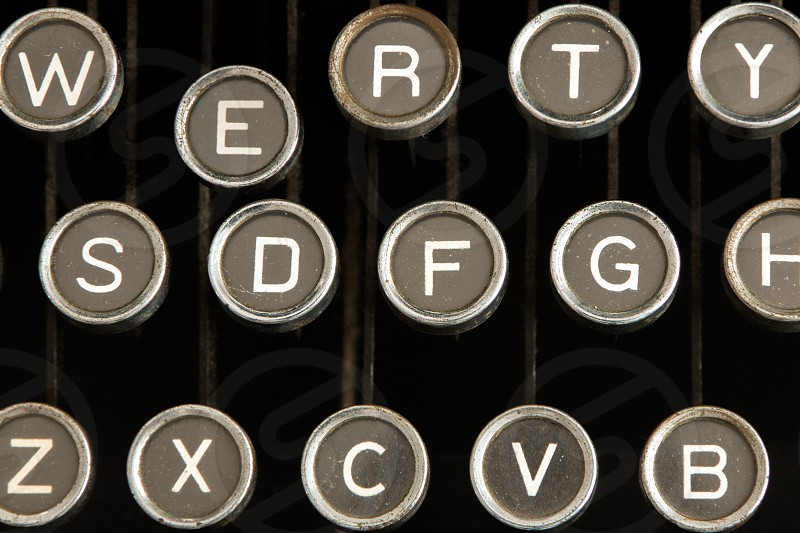 Keys of a old typewriter with one key depressed. photo