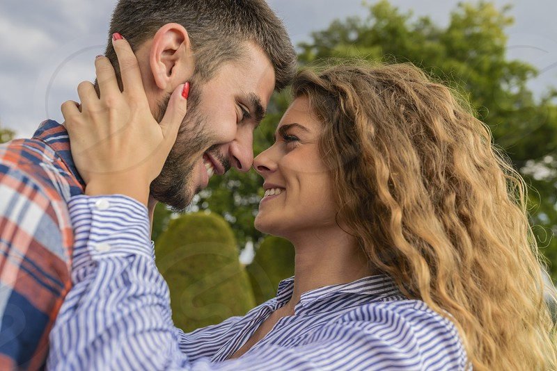 Happy stylish couple in the romantic moment with sweetest emotions. Romantic moment. photo