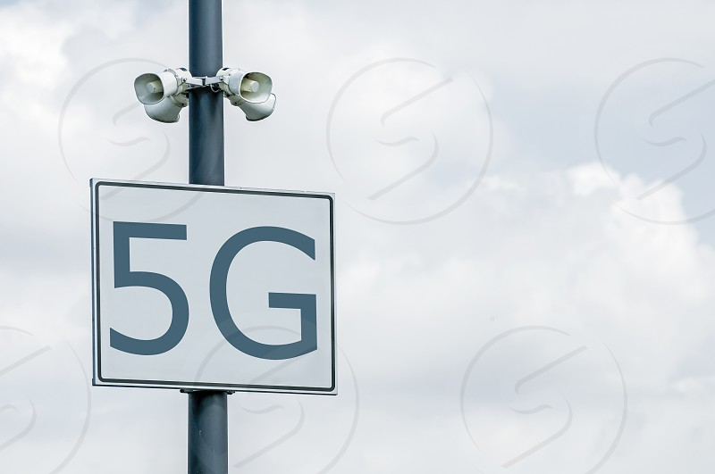 5G annotation on signboard and loudspeakers. High speed mobile internet. 5G zone. photo