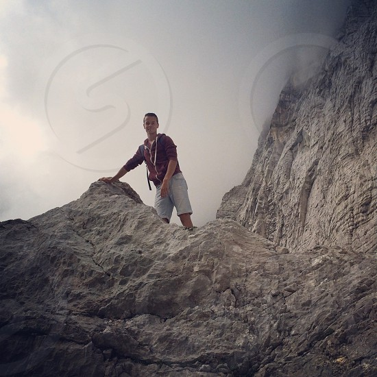 boy standing at rocky mountain photo
