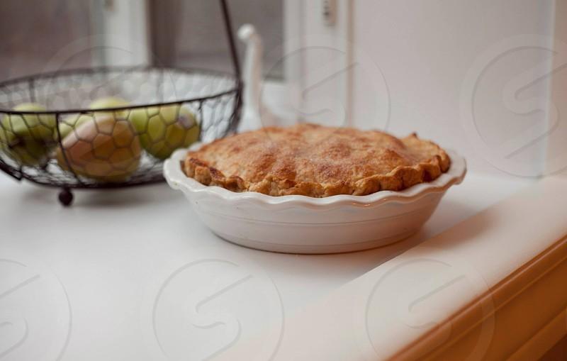 Apple pie in window photo