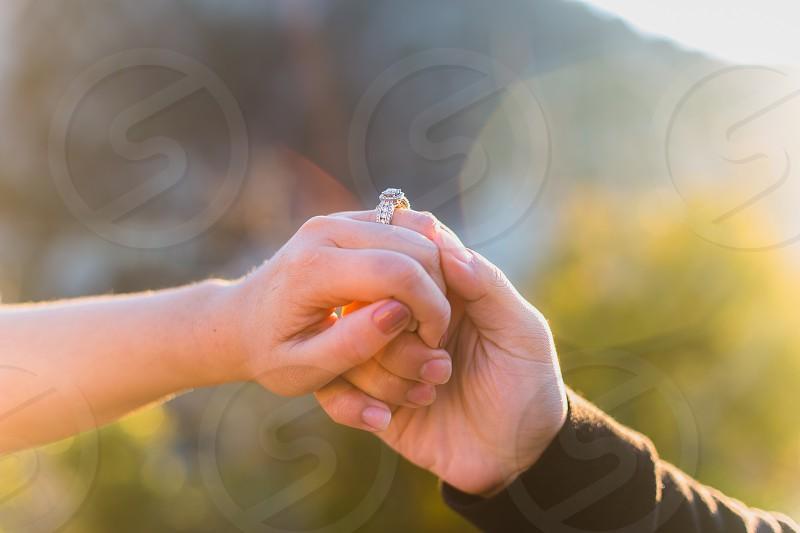 Ring hand hands engagement ring sun warm bikes diamond  photo