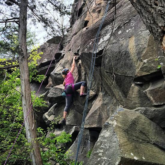 Female outdoor rock climber photo