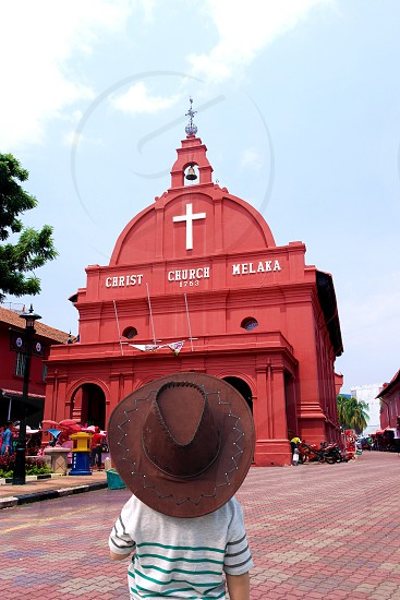 person standing in front of christ church melaka photo