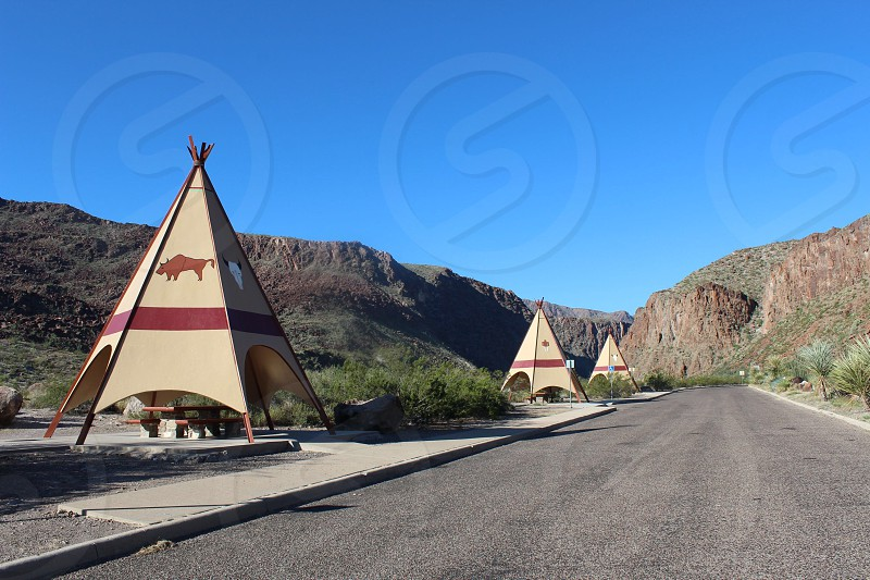 brown and red tents beside the road photo
