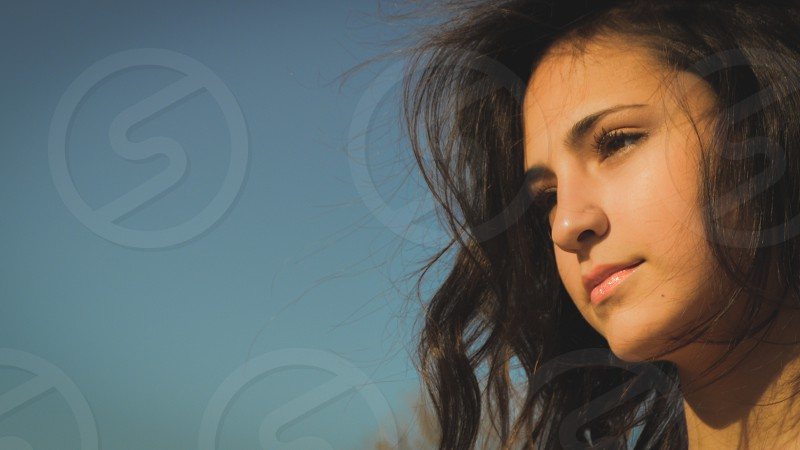 sun kissed face of girl with copy space photo